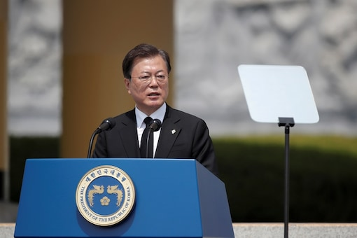 FILE PHOTO:  South Korean President Moon Jae-in speaks during a Memorial Day ceremony at the national cemetery in Daejeon, South Korea,  June 6, 2020. Lee Jin-man/Pool via REUTERS/File photo