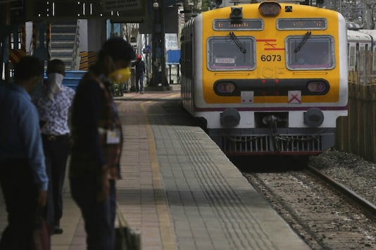 File photo: Passengers stand at a platform as local train services resume only for essential service workers in Mumbai, India, Monday, June 15. (AP Photo/Rafiq Maqbool)