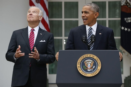 FILE - In this Nov. 9, 2016, file photo, Vice President Joe Biden, left, looks upwards while listening to President Barack Obama speak in the Rose Garden of the White House in Washington. Nearly eight years after he was last on the ballot, Obama is emerging as a central figure in the 2020 presidential election. Democrats are eagerly embracing Obama as a political wingman for Joe Biden, who spent two terms by his side as vice president. Obama remains the party's most popular figure, particularly with black voters and younger Democrats. (AP Photo/Pablo Martinez Monsivais, File)