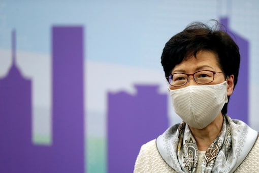 Hong Kong Chief Executive Carrie Lam, wearing a face mask following the coronavirus disease (COVID-19) outbreak, holds a news conference in Beijing, China, June 3, 2020. REUTERS/Carlos Garcia Rawlins