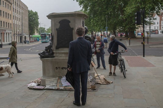 The plinth of the statue of Edward Colston in Bristol, England, now surrounded by messages of support for the Black Lives Matter movement, June 11, 2020. (James Beck/The New York Times)