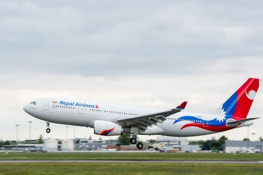 File photo of a Nepal Airlines flight taking off from Tribhuvan International Airport in Kathmandu, Nepal. (Image Source: Reuters)