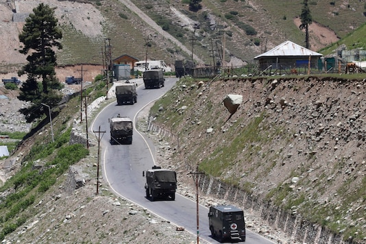 An Indian Army convoy moves along Srinagar-Leh national highway at Gagangeer in east Kashmir's Ganderbal district on Tuesday. (Reuters)