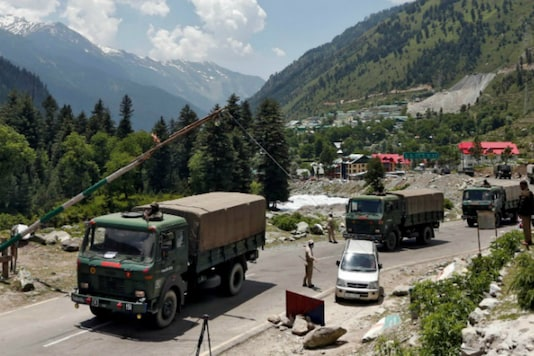 Indian army trucks move along a highway leading to Ladakh, at Gagangeer in Kashmir's Ganderbal district. (Reuters)