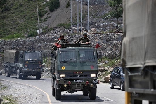 An Indian army convoy moves on the Srinagar- Ladakh highway at Gagangeer, north-east of Srinagar, India, Wednesday. (PTI)
