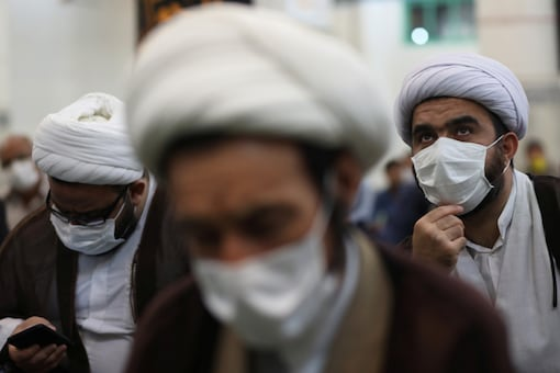 FILE PHOTO: Iranian clerics wearing protective face masks attend the Friday prayers in Qarchak Jamee Mosque, following the outbreak of the coronavirus disease (COVID-19), in Tehran province, in Qarchak, Iran, June 12, 2020. WANA (West Asia News Agency)/Ali Khara via REUTERS