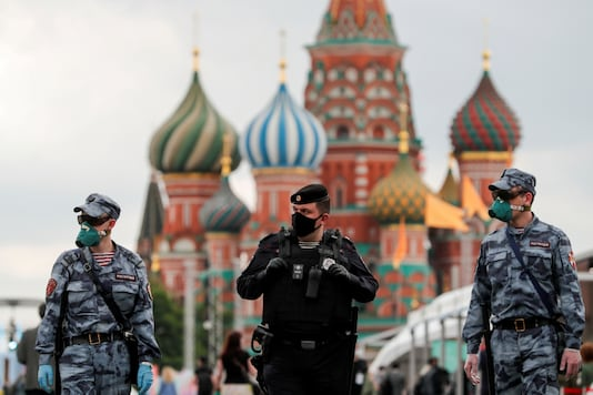 FILE PHOTO: Russian law enforcement officers wearing protective face masks, used as a preventive measure against the spread of the coronavirus disease (COVID-19), walk at the annual Red Square Book Fair in central Moscow, Russia June 6, 2020. REUTERS/Shamil Zhumatov/File Photo