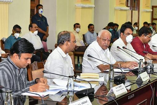 File photo of Karnataka chief minister BS Yediyurappa along with state ministers at a meeting for coronavirus. (PTI Photo)