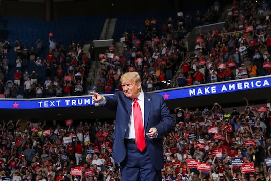 U.S. President Donald Trump points at the crowd as he enters his first re-election campaign rally in several months in the midst of the coronavirus disease (COVID-19) outbreak, at the BOK Center in Tulsa, Oklahoma, U.S., June 20, 2020. REUTERS/Leah Millis