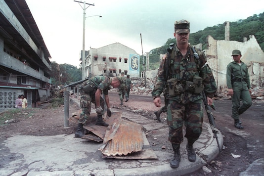Joint U.S. military and Panamanian military patrols walk the streets through the Chorrillo district destroyed during the US invasion while US military help in the clean up effort on December 29, 1989. (Reuters)
