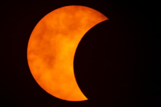 A photo shows a partial solar eclipse observed in Bangkok, Thailand. (Image: Reuters)