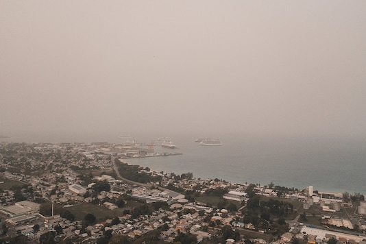 Dust coming from the Sahara desert floats over the city of Bridgetown, Barbados, June 22, 2020, in this picture obtained from social media.  Alexander James/via REUTERS