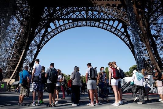 People queue up prior to visit the Eiffel Tower, in Paris on Thursday, (AP Photo/Thibault Camus)