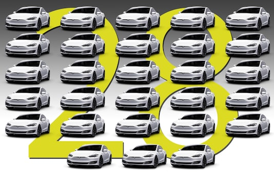 These are 28 Tesla Model 3 sedans - the amount that was mistakenly purchased by a German man. (Photo altered by: News18)