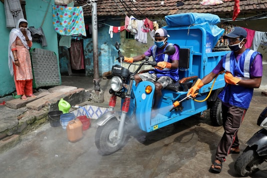 For representation: A municipal worker spras disinfectant to sanitise a slum in Kolkata. (Reuters)