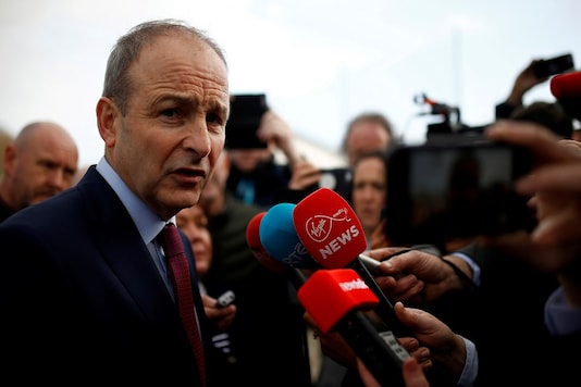 FILE PHOTO: Fianna Fail leader Micheal Martin speaks to media after exit polls were announced in Ireland's national election, in Cork, Ireland, February 9, 2020. REUTERS/Henry Nicholls/File Photo