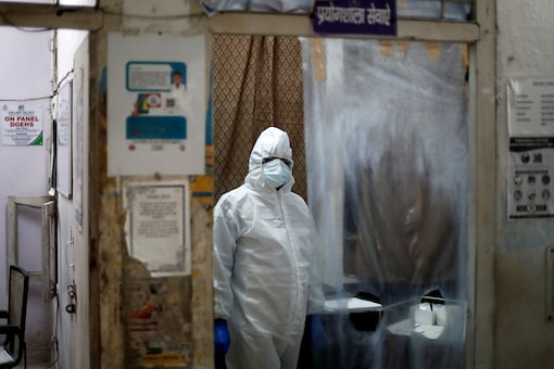 A health worker in personal protective equipment (PPE) waits for the next person to get tested for the coronavirus disease (COVID-19) at a local health centre, amid the spread of the disease, in New Delhi. (Reuters)