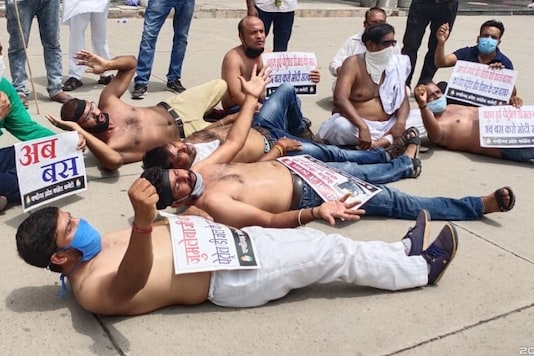 Congress party workers seen protesting fuel price hike in Chandigarh, Punjab. (News18)