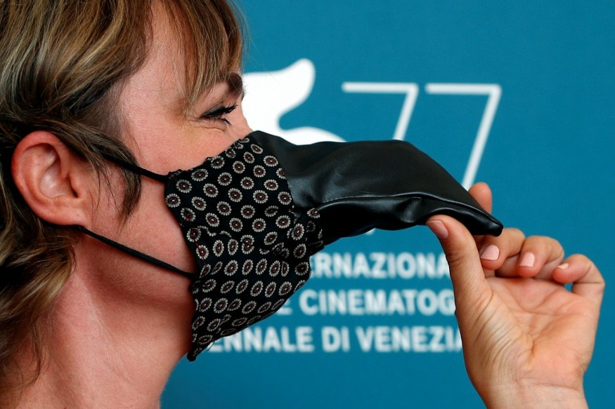 Actress Radha Mitchell made heads turn at the Venice Film Festival as she was seen walking down the red carpet wearing a Plague Doctor Mask. (Image: Reuters)