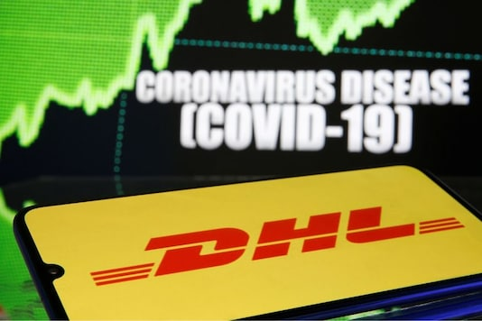 DHL logo is seen in front of displayed coronavirus disease (COVID-19) in this illustration taken March 19, 2020. REUTERS/Dado Ruvic/Illustration