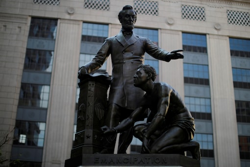FILE PHOTO: The Emancipation Memorial, a statue depicting U.S. President Abraham Lincoln standing over a freed slave that has become controversial for some activists during protests against racial inequality in the aftermath of the death in Minneapolis police custody of George Floyd, stands in Boston, Massachusetts, U.S., June 23, 2020. REUTERS/Brian Snyder/File Photo