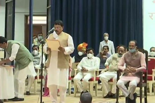 Pradhuman Singh Tomar takes oath as Cabinet Minister at Raj Bhawan in Bhopal on Thursday.