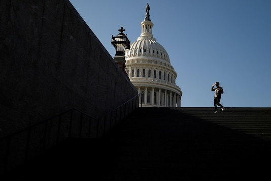 A visitor walks outside of the US Capitol. (Reuters)