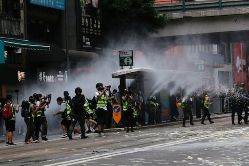 A police officer is seen injured as people protest the new security law during the anniversary of Hong Kong's handover to China from Britain, in Hong Kong, China July 1, 2020, in this picture obtained from social media. (HONG KONG POLICE FORCE/via REUTERS)