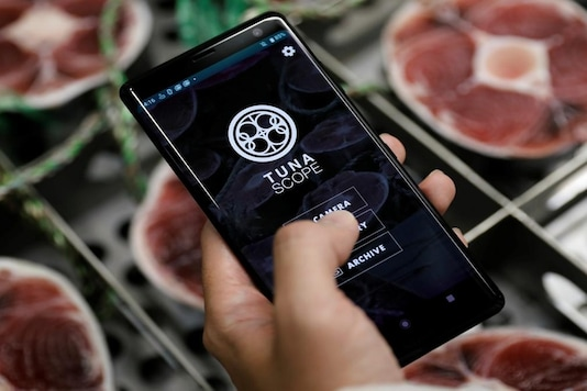File photo of 'Tuna Scope', an AI-based system that judges the quality of natural tuna using cross-sectional images of their tails. (Image Source: Reuters)