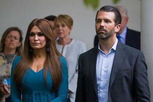 Donald Trump Jr., walks with his girlfriend Kimberly Guilfoyle.