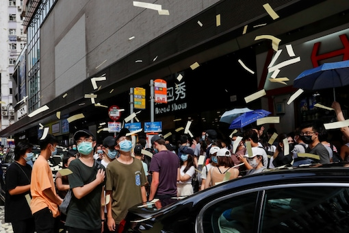 Anti-national security law protesters throw mock paper money during a march against national security law at the anniversary of Hong Kong's handover to China from Britain, in Hong Kong, China July 1, 2020. REUTERS/Tyrone Siu/Files