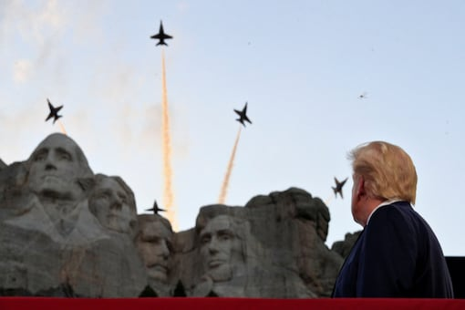U.S. President Donald Trump looks at U.S. Navy Blue Angels aerial flypast as he and first lady Melania Trump attend South Dakota's U.S. Independence Day Mount Rushmore fireworks celebrations at Mt. Rushmore in Keystone, South Dakota, U.S., July 3, 2020. REUTERS/Tom Brenner