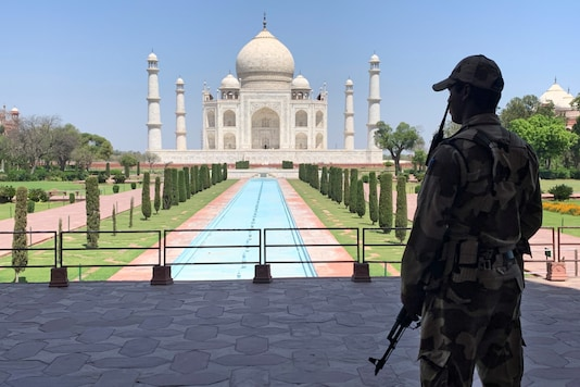 A Central Industrial Security Force (CISF) personnel stands guard inside the empty premises of the historic Taj Mahal during a 21-day nationwide lockdown to slow the spreading of the coronavirus disease (COVID-19), in Agra, India, April 2, 2020. REUTERS/Sunil Kataria/Files