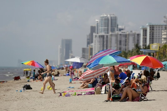 People sit on Hollywood Beach In hard-hit South Florida.  (AP Photo/Lynne Sladky)