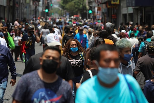 People walk near Zocalo Square during the gradual reopening of commercial activities in the city, as the coronavirus disease (COVID-19) outbreak continues, in Mexico City, Mexico July 6, 2020. REUTERS/Henry Romero