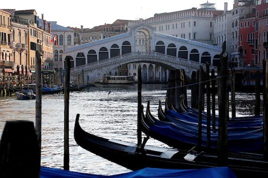 File photo of Rialto bridge at Grand Canal, amid the coronavirus disease (COVID-19) outbreak, in Venice. (Reuters)