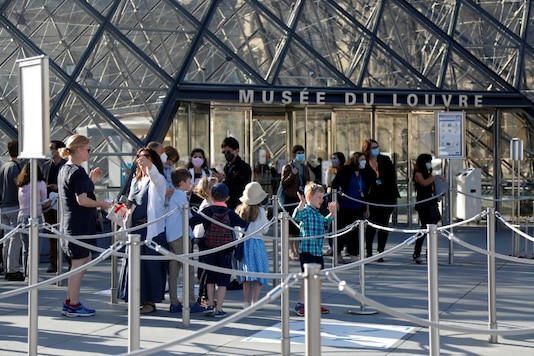 File photo of visitors in front of the Louvre Pyramid designed by Chinese-born U.S. architect Ieoh Ming Pei in Paris as the museum reopens its doors to the public after almost 4-month closure due to the coronavirus disease (COVID-19) outbreak in France. (Image: Reuters)