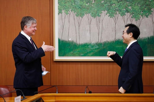 US Deputy Secretary of State Stephen Biegun, left, is greeted by his South Korean counterpart Lee Do-hoon during their meeting at the Foreign Ministry in Seoul Wednesday, July 8, 2020. (Kim Hong-ji/Pool Photo via AP)