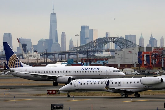 File photo of United Airlines passenger jets taxi at Newark Liberty International Airport, New Jersey. (Image Source: Reuters)