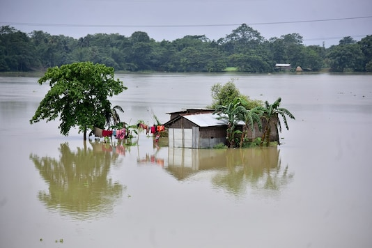 A partially submerged house is seen at the flood-affected Mayong village in Morigaon district, in the northeastern state of Assam.  REUTERS/Anuwar Hazarika - RC2XIH9MATOZ