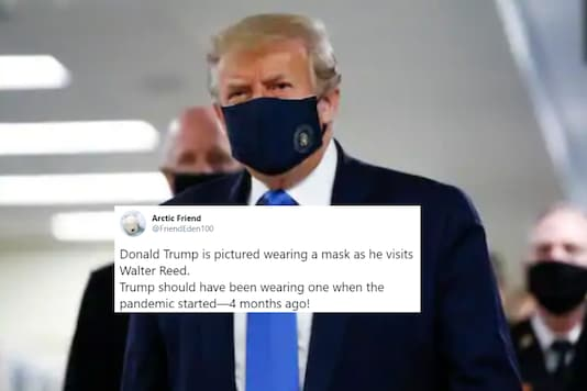 US President Donald Trump wears a mask as he walks down the hallway during his visit to Walter Reed National Military Medical Center in Bethesda, Md. on, Saturday, July 11, 2020. (AP Photo)