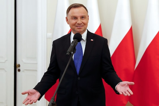 Polish President and presidential candidate of the Law and Justice (PiS) party Andrzej Duda talks to the media after the announcement of the first exit poll results on the second round of the presidential election, at the Presidential Palace in Warsaw, Poland, July 12, 2020. REUTERS/Aleksandra Szmigiel