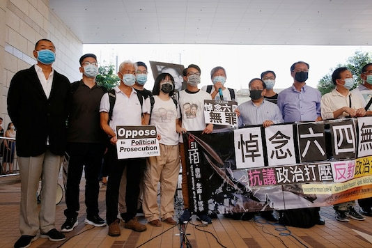 Pro-democracy activists, including Lee Cheuk-yan and media tycoon Jimmy Lai, arrive at the West Kowloon Courts before entering a courtroom to face charges related to illegal assembly during Tiananmen vigil, in Hong Kong, China July 13, 2020. REUTERS/Tyrone Siu