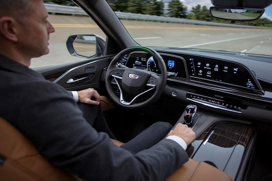 A GM test driver sits in a 2021 Cadillac Escalade SUV with General Motors' Super Cruise hands-free driving assistance. (Image Source: Reuters)