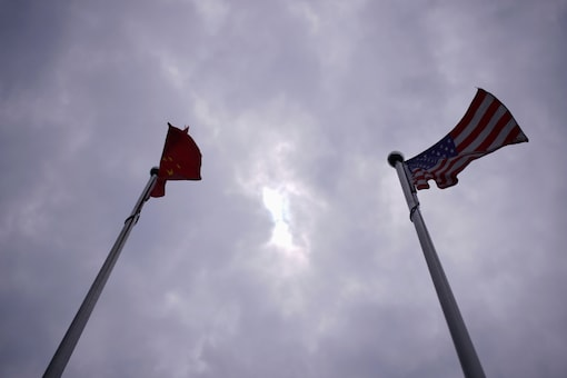Chinese and U.S. flags flutter in Shanghai, China June 3, 2020. REUTERS/Aly Song
