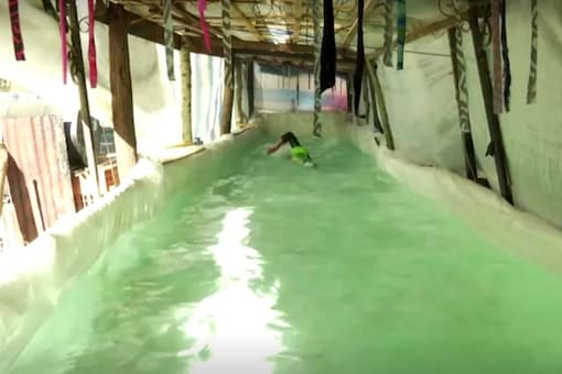 Sebastian Galleguillo, 18, practicing in his DIY pool.