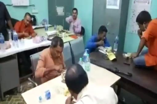Videograb of BJP workers being served food at a police station in Jalpaiguri. (News18)
