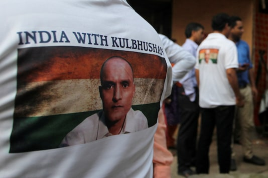 A file photo of Kulbhushan Jadhav on a person's T-shirt in Mumbai. (Reuters)