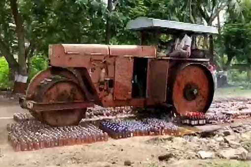 Video grab shows the bottles being crushed by a road roller. (ANI)