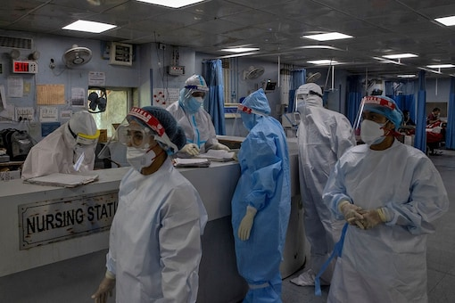 Medical workers wearing personal protective equipment (PPE) are seen inside an ICU for patients suffering from the coronavirus disease (COVID-19).